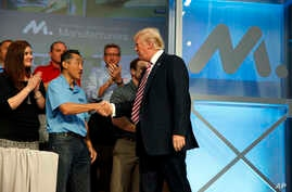 President Donald Trump shakes hands as he arrives to speak to the National Association of Manufactures at the Mandarin Oriental hotel, Sept. 29, 2017, in Washington.