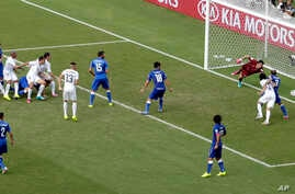 Uruguay's Diego Godin (3) scores his side's first goal during the group D World Cup soccer match between Italy and Uruguay at the Arena das Dunas in Natal, Brazil, Tuesday, June 24, 2014.