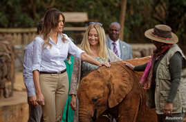 U.S. first lady Melania Trump pets a baby elephant, accompanied by CEO Angela Sheldrick and Kenya's first lady Margaret Kenyatta, right, at the David Sheldrick Wildlife Trust Elephant Orphanage in Nairobi, Kenya, Oct. 5, 2018.