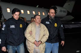 "In this photo provided U.S. law enforcement, authorities escort Joaquin ""El Chapo"" Guzman, center, from a plane to a waiting caravan of SUVs at Long Island MacArthur Airport, Jan. 19, 2017, in Ronkonkoma, N.Y."