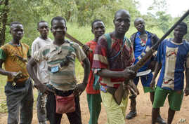 "FILE - Fighters from a Christian militia movement known as the ""anti-balaka"" display their makeshift weaponry in the village of Boubou, halfway between the towns of Bossangoa and Bouca, in the Central African Republic."