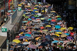 Thousands of protesters raise umbrellas during a rally to support young activists Joshua Wong, Nathan Law and Alex Chow in downtown Hong Kong, Aug. 20, 2017.