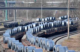 Steel coils sit on wagons when leaving the thyssenkrupp steel factory in Duisburg, Germany, March 2, 2018. German officials and industry groups warned that U.S. President Donald Trump risked sparking a trade war with his closest allies when he backed...