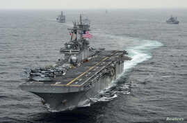 FILE - The amphibious assault ship USS Boxer  transits the East Sea during an exercise, March 8, 2016. The Boxer Amphibious Readiness Group has been sent to waters off the coast of Yemen to help provide medical aid and maritime security.