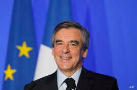 French conservative presidential candidate Francois Fillon smiles during a speech on defense policy, March 31, 2017 in Paris.