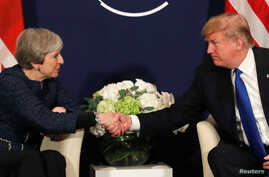 U.S. President Donald Trump shake hands with Britain's Prime Minister Theresa May during the World Economic Forum (WEF) annual meeting in Davos, Switzerland, Jan. 25, 2018.