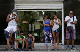 FILE - Cubans use the internet via public Wi-Fi in Havana, Cuba, Sept. 5, 2016. By the end of the year, Cuba promises to bring the internet to homes in Old Havana.
