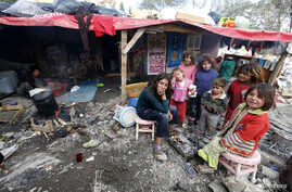 Syrian refugee children gather around fire near makeshift tents, central Ankara, Oct. 5, 2013.