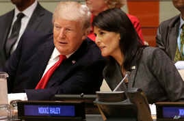 President Donald Trump speaks with U.S. Ambassador to the United Nations Nikki Haley before a meeting during at the United Nations,  Sept. 18, 2017.