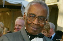"""FILE - Actor Robert Guillaume who starred on the television series """"Benson,"""" """"Soap,"""" and Sports Night"""" poses as he arrives for the ABC television networks 50th anniversary in Hollywood, California, March 16, 2003."""