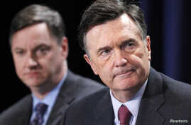 """FILE - Dennis Lockhart, President, Federal Reserve Bank of Atlanta, and Charles Evans (L), President and CEO, Federal Reserve Bank of Chicago, take part in a panel discussion titled """"Twist and Shout: The Limits of U.S. Monetary Policy"""" at the Milken"""