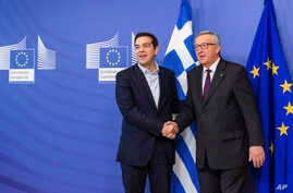 European Commission President Jean-Claude Juncker, right, welcomes Greece's Prime Minister Alexis Tsipras upon his arrival at the European Commission headquarters in Brussels, Feb. 4, 2015.