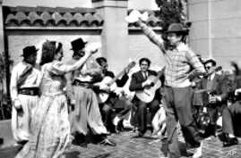 Walt Disney joins a folkloric group in Buenos Aires.