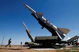 FILE - A serviceman walks past anti-aircraft defense mobile missile systems at the Ashuluk shooting range outside Astrakhan, Russia Aug. 5, 2017.
