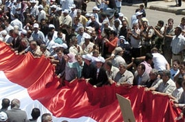 Syrians Take to Streets as Clinton Warns Assad Regime