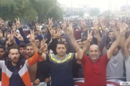 In this photo of sugar plantation workers who began a protest in Shush, Iran, Nov. 5, 2018, two protest leaders detained for alleged security offenses can be seen: Moslem Armand (left) and Ismail Bakhshi (second from left).