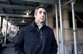 FILE - Michael Cohen, former lawyer to President Donald Trump, leaves his apartment building in New York, Dec. 7, 2018.