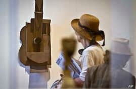 """Pablo Picasso's sheet metal and wire """"Guitar"""" from 1914, is one of 140 sculptures from his entire career is shown during the Museum of Modern Art (MoMA) press preview, Sept. 9, 2015, in New York."""