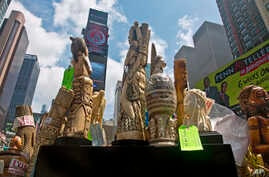 U.S. government display confiscated illegal ivory before crushing more than a ton in an effort to halt elephant poaching and ivory trafficking, Friday, June 19, 2015 at Times Square in New York.