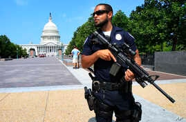 Capitol Hill Police officer Nathan Rainey stands guard on Capitol Hill in Washington, after House Majority Whip Steve Scalise of Louisiana was shot during a congressional baseball practice in Alexandria, Va., June 14, 2017.