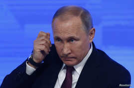 FILE - Russian President Vladimir Putin attends his annual end-of-year news conference in Moscow, Russia, Dec. 23, 2016.