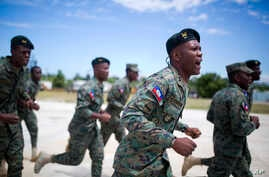 FILE - Members of Haiti's new national military force run and chant during training at a former U.N. base in Gressier, Haiti, April 11, 2017.