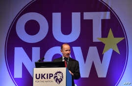 FILE - In this photo taken on Sept.  29, 2017, UK Independence Party's newly elected leader, Henry Bolton greets delegates on the first day of the UK Independence Party (UKIP) National Conference in Torquay, south-west England.
