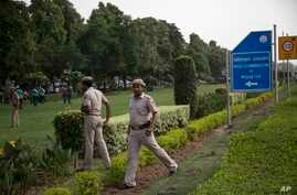 Indian policemen secure the area outside the Pakistan High Commission as Kashmiri separatist leaders arrive for talks with the Pakistani high commissioner in New Delhi, India, Aug. 19, 2014.