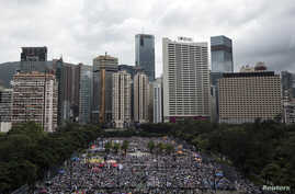 Thousands of pro-democracy protesters gather to march in the streets to demand universal suffrage in Hong Kong, July 1, 2014.