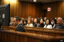 Oscar Pistorius sits in the dock as he listens to cross questioning about the events surrounding the shooting death of his girlfriend Reeva Steenkamp at court during his trial in Pretoria, South Africa, March 10, 2014.