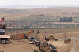 U.S. forces set up a new base in Manbij, Syria, May 8, 2018.