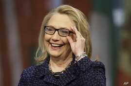 """Secretary of State Hillary Rodham Clinton adjusts her glasses during a """"Global Townterview"""" at the Newseum, Washington, Jan. 29, 2013."""