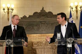 Greek Prime Minister Alexis Tsipras , right, and Russian President Vladimir Putin address to journalists during a joint press conference after their meeting in Athens, Friday, May 27, 2016.