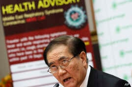 Public Health Minister Rajata Rajatanavin talks to reporters during press conference in Bangkok, Thailand, June 18, 2015.
