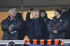 Rinat Akhmetov is seen flanked at a soccer match by Sweden's Foreign Minister Carl Bildt (L) and Poland's Foreign Minister Radoslaw Sikorski (R) Nov. 23, 2011, in Donetsk, Ukraine.