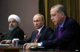 Turkey's President Recep Tayyip Erdogan, right, Russia's President Vladimir Putin, center, and Iran's President Hassan Rouhani are seen at a news conference in Russia's Black Sea resort of Sochi, Russia, Nov. 22, 2017. The three are due to meet Wedne