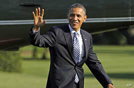 President Barack Obama walks across the South Lawn of the