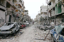 The damaged cars and buildings are seen in the besieged town of Douma, Eastern Ghouta, Damascus, Syria February 25, 2018.