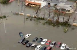 A still image taken from video shows submersed cars in floods water after Hurricane Maria battered Caguas, Puerto Rico Sept. 20, 2017.