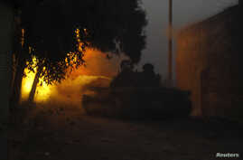 A Free Syrian Army tank fires a shell towards forces loyal to President Bashar Al-Assad in Aleppo, Nov.30, 2013.