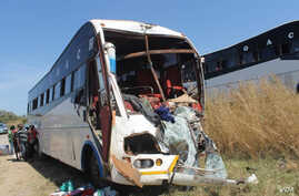 Three people died when a passenger bus and a truck crashed into each other on the Aswa bridge on the Juba to Nimule road in South Sudan on Thursday, Dec. 11, 2014. Hundreds of people have died in accidents on the road since it opened in 2009.