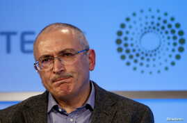 FILE - Former Russian tycoon Mikhail Khodorkovsky speaks during a Reuters Newsmaker event at Canary Wharf in London, Britain, Nov. 26, 2015.