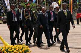 Sudan's President Omar al-Bashir (C) walks during the swearing in ceremony of Uganda's President Yoweri Museveni as newly elected President in Kampala on May 12, 2016.