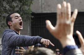 Activist Ahmed Doma shouts slogans against Egyptian President Mohamed Morsi and the Muslim Brotherhood during the funeral of activists Mohamed el-Gendy and Amr Saad in Cairo February 4, 2013.