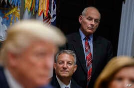 White House chief of staff John Kelly listens as President Donald Trump speaks during a meeting on tax policy with business leaders in the Roosevelt Room of the White House, Oct. 31, 2017.
