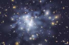 NASA Hubble Space Telescope image shows the distribution of dark matter in the center of the giant galaxy cluster Abell 1689, containing about 1,000 galaxies and trillions of stars, (File photo).