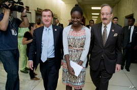 Deborah Peter, center, walks with House Foreign Affairs Committee Chairman Rep. Ed Royce, R-Calif., left, and, the committee's ranking member Rep. Eliot Engel, D-N.Y. to a hearing room on Capitol Hill in Washington, Wednesday, May 21, 2014.