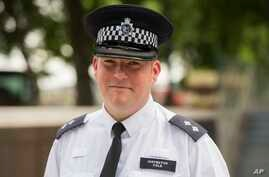 Metropolitan Police Inspector Jim Cole poses for a photo at New Scotland Yard, London, where he described his role in the police response to the London Bridge attack, June 9, 2017. One of the first police officers on the scene of the London Bridge at