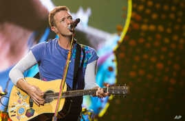 AP Chris Martin from the band Coldplay performs at MetLife Stadium in East Rutherford, New Jersey.