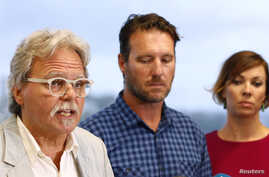 John Ruszczyk, the father of Justine Damond, speaks as he stands next to his son Jason Ruszczyk and Jason's wife Katarina, during a media conference in Sydney, Dec. 21, 2017.